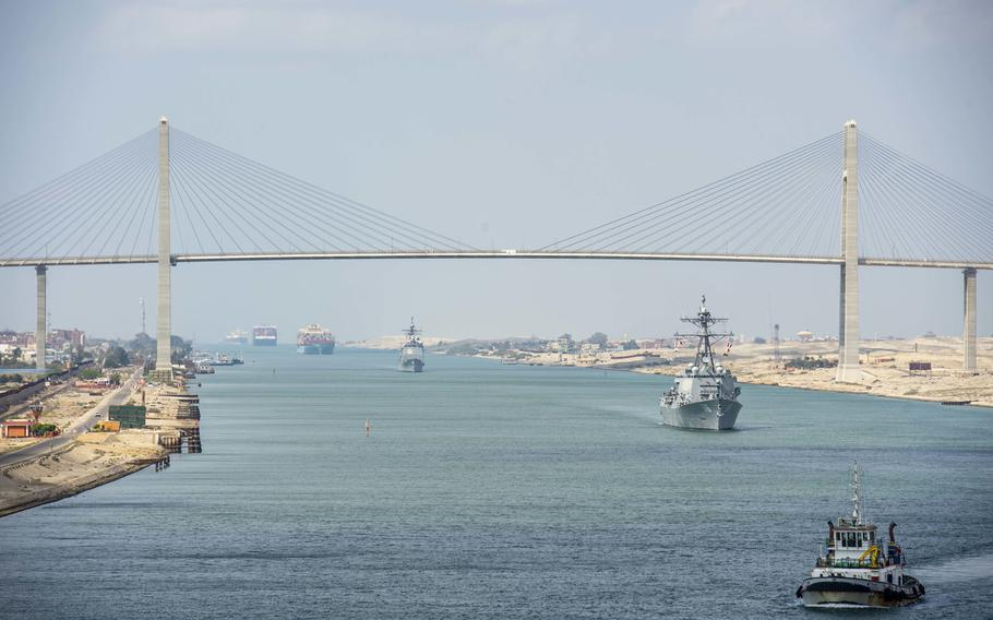 The cruiser USS Monterey, left, and the destroyer USS Thomas Hudner sail behind the aircraft carrier USS Dwight D. Eisenhower during a Suez Canal transit, April 2, 2021.