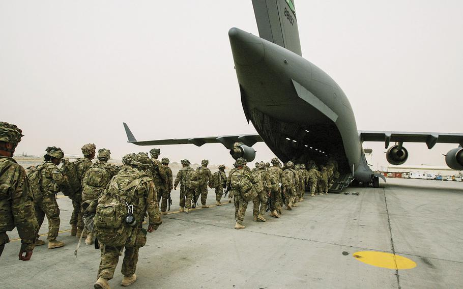 In a March, 2012 photo, soldiers with 3rd Brigade Combat Team, 10th Mountain Division load on to an Air Force C-17 on March 3 at Kandahar Air Field for their return home to Fort Drum, N.Y., after a year in Afghanistan.