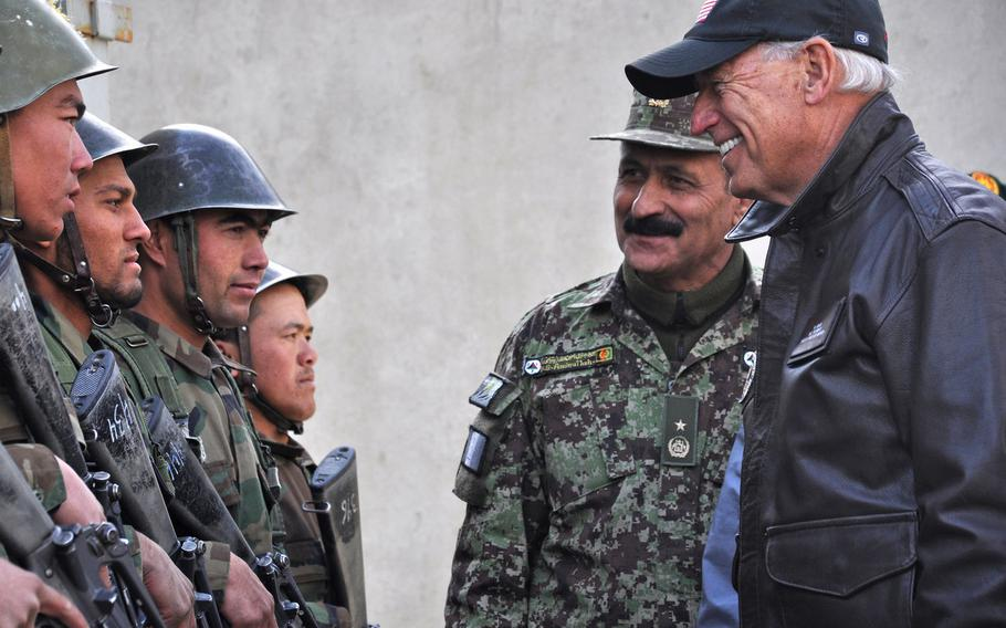 In November 2011, Afghan National Army Brig. Gen. Amlaqullah Patyani introduces then-Vice President Joe Biden to Afghan recruits in Kabul. The Biden administration plans to withdraw all U.S. forces from Afghanistan by Sept. 11, 2021.