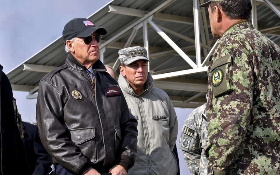 Afghan national army Brig. Gen. Amlaqullah Patyani briefs then-Vice President Joe Biden and International Security Force commander Gen. David Petraeus on activities at a Kabul troop training facility in 2011. The Biden administration plans to withdraw all U.S. forces from Afghanistan by Sept. 11, 2021.