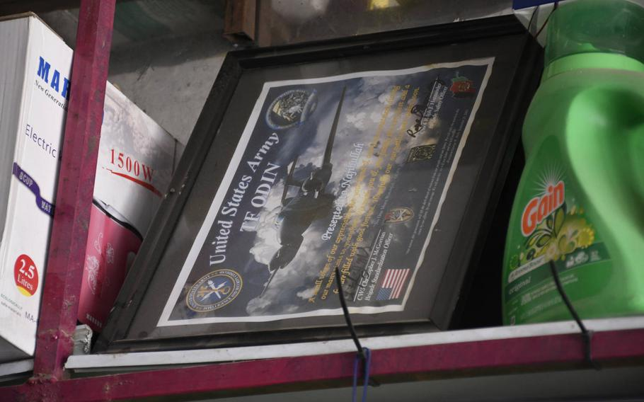 A certificate from U.S. troops to an Afghan shopkeeper is available for sale in the town outside Bagram Airfield, Afghanistan. The soldiers thank a shopkeeper for his courtesy during ''our many visits to your shop,'' underscoring the deep connection between the base and the local economy.