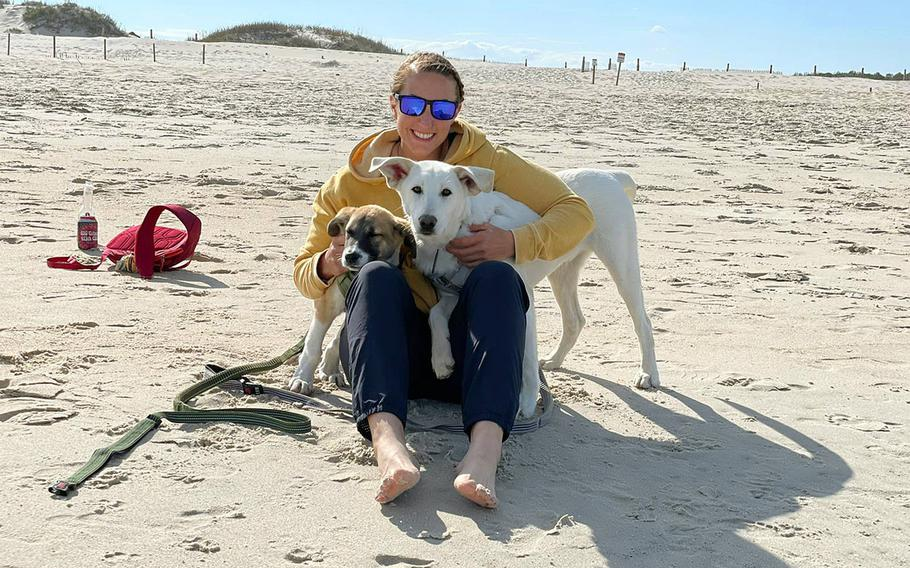 Staff Sgt. Katie Catania, an Army reservist, brought Charley, left, and Flea, right, back to the U.S. with her from Afghanistan. Catania said she was concerned about what would happen to the dogs.