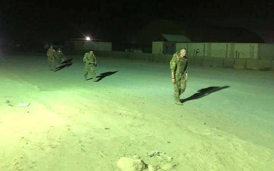 U.S. soldiers with the 28th Expeditionary Combat Aviation Brigade test their minds and bodies at Camp Buehring, Kuwait, during an 18.6-mile timed march, aiming to earn the Norwegian Foot March Badge, April 17, 2021. The event required soldiers to march in their full uniform while wearing a rucksack weighing 25 pounds.