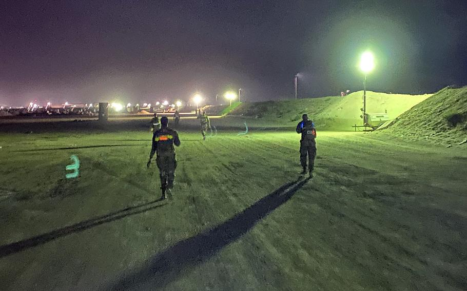 U.S. soldiers with the 28th Expeditionary Combat Aviation Brigade march 18.6 miles in a timed event for the chance to earn the Norwegian Foot March badge, April 17, 2021. The march required soldiers to wear a 25-pound bag in full uniform.