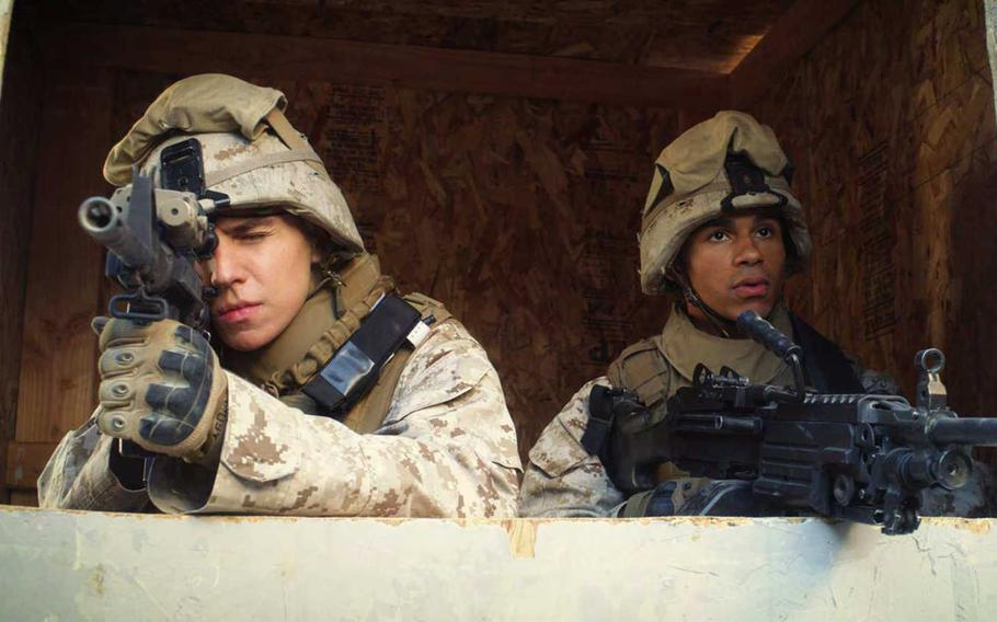 Michael Grant as Lance Cpl. Jordan Haerter, left, and Noah Gray-Cabey as Lance Cpl. Jonathan Yale in a scene from the film ''The 11th Order.'' Yale and Haerter died stopping a bomb-laden truck in Iraq in 2008, saving the lives of many of their comrades.