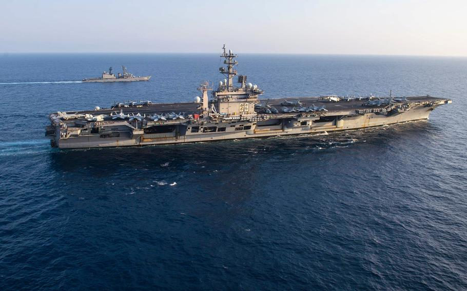 USS Dwight D. Eisenhower (CVN 69) in the foreground operates in the Arabian Sea on April 19, 2021.