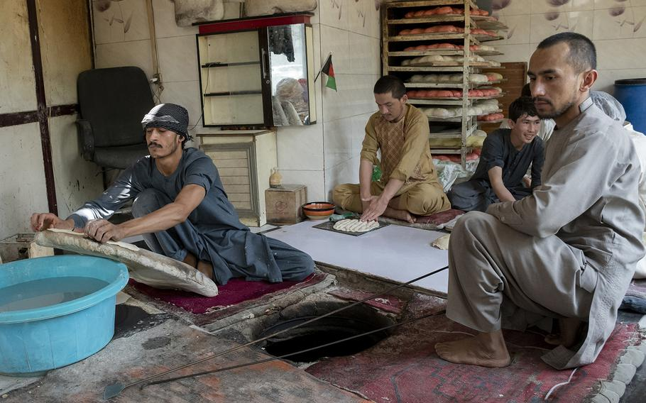 Zalmai Faqirzada, left, makes bread with his colleagues at a bakery close to Kabul's Green Zone on Sunday, May 2, 2021. Faqirzada said he feared violence would escalate in the city as foreign forces leave.