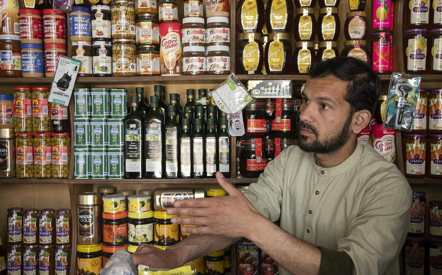 Grocer Talha Hairan on Sunday, May 2, 2021, explains how he and others in his Kabul neighborhood worry that violence will increase as foreign forces withdraw from Afghanistan. Hairan's shop is next to Kabul's Green Zone that houses NATO's Afghanistan headquarters.