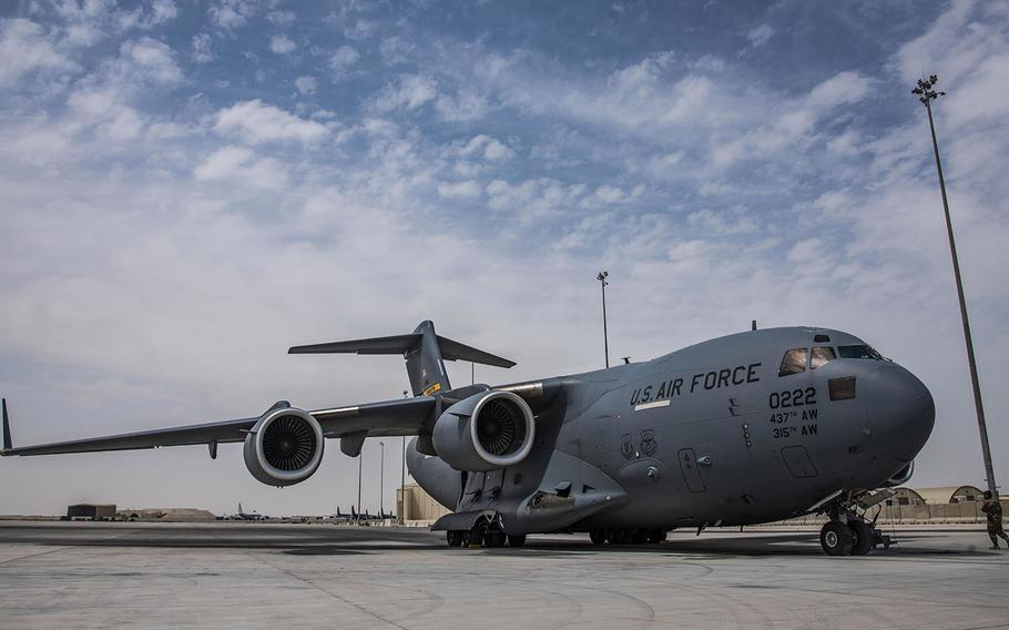 In an April 27, 2021 photo, a C-17 Globemaster III assigned to Joint Base Charleston, S.C., parks on the flight line at Al Udeid Air Base, Qatar. C-17s and other mobility aircraft around the U.S. Air Forces Central theater are assisting with the safe and orderly drawdown operations from Afghanistan.