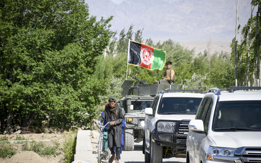 A convoy belonging to Abdul Qayum Rahimi, governor of the province of Logar in Afghanistan, travels through Taliban-contested territory during a cease-fire May 14, 2021. Logar residents are pessimistic about the prospect of peace in the country as U.S. and coalition troops withdraw.