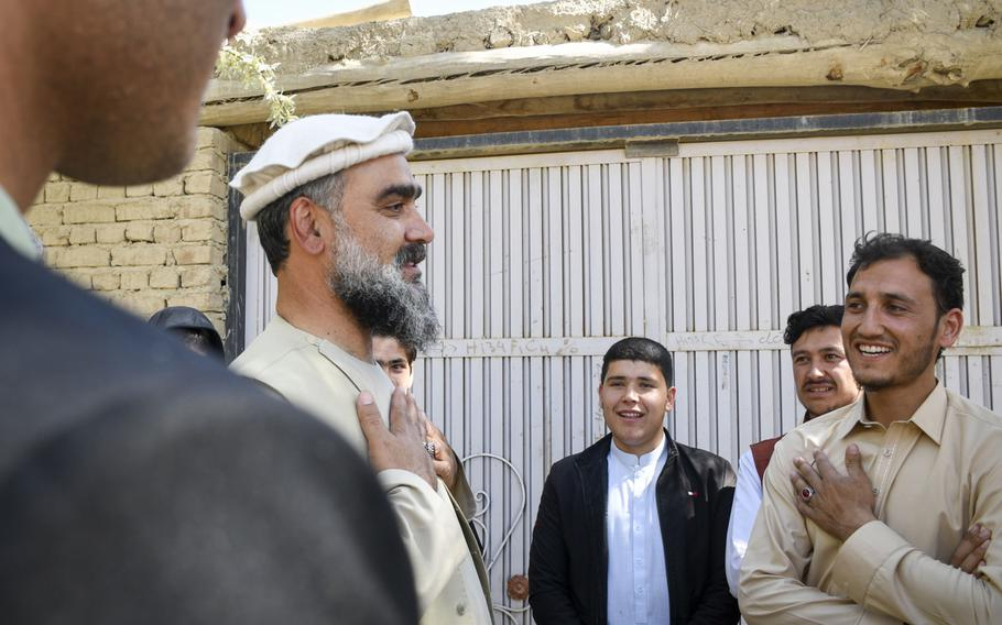 Abdul Qayum Rahimi, governor of the province of Logar in Afghanistan, meets with residents of a village in a Taliban-contested area during a cease-fire May 14, 2021. Rahimi said it was important to show that the government was willing to meet with people, even members of the Taliban.
