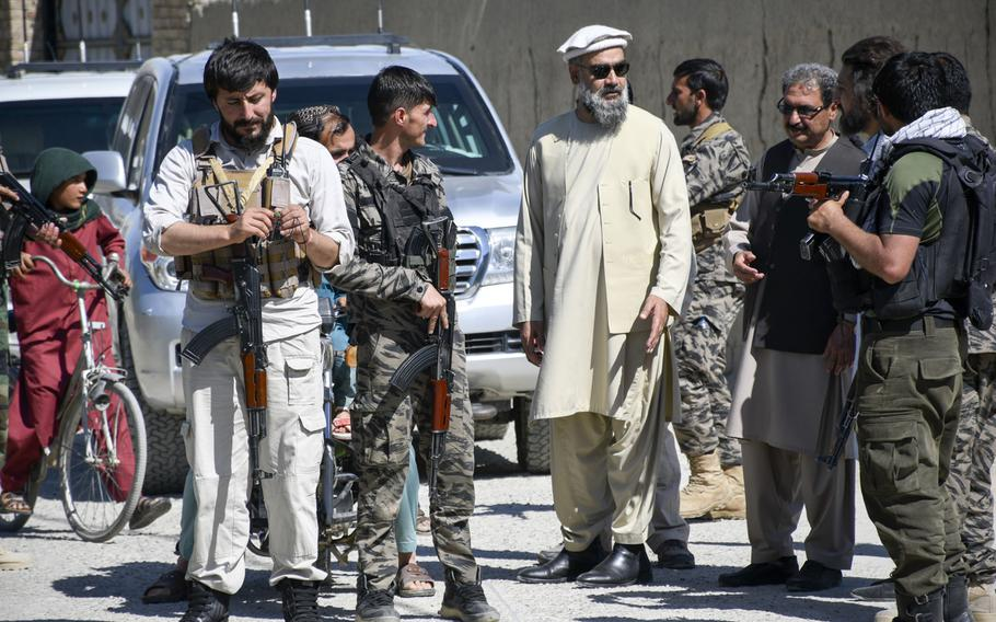Heavily armed bodyguards escort Abdul Qayum Rahimi, governor of the province of Logar in Afghanistan, as he travels through Taliban-contested territory during a cease-fire May 14, 2021.
