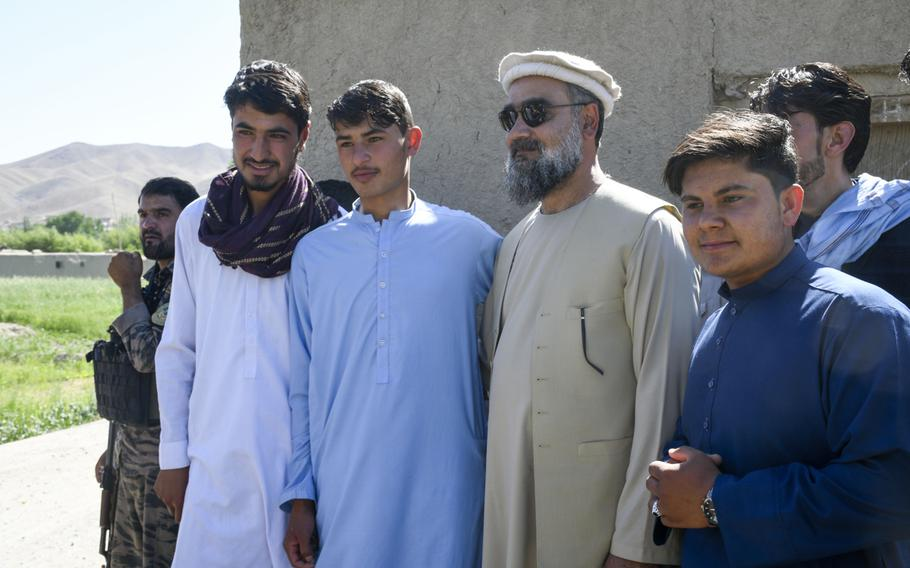 Abdul Qayum Rahimi, governor of the province of Logar in Afghanistan, meets with residents of a Taliban-contested village during a cease-fire May 14, 2021.