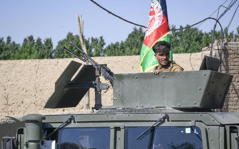 An Afghan soldier guards a convoy of vehicles belonging to the governor of the province of Logar in Afghanistan as part of a visit to a Taliban-contested village during a cease-fire May 14, 2021.