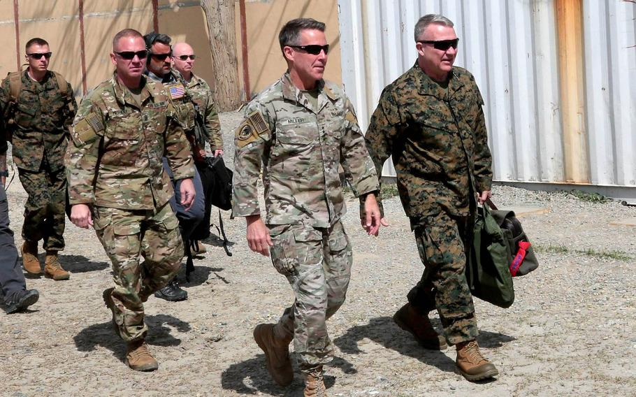 U.S. Marine Corps Gen. Kenneth F. McKenzie Jr., front right, head of U.S. Central Command, meets with Gen. Scott Miller, front left, Resolute Support mission commander, during his visit to Kabul, Afghanistan, April, 5, 2019. Miller became the longest-serving commander of American and NATO forces in Afghanistan on March 5, 2021.