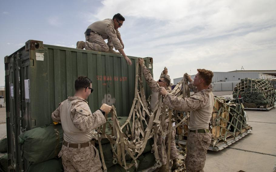 U.S. Marines assigned to the Special Purpose Marine Air-Ground Task Force – Crisis Response – Central Command 19.2, begin their transfer of Taqaddum Air Base, Iraq, Mar. 25, 2020.