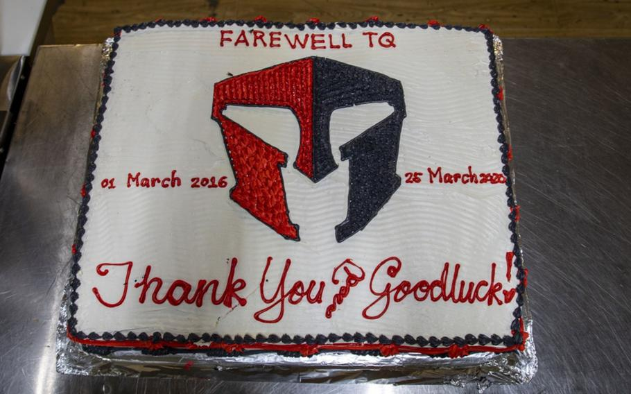 """""""Thank you and good luck,"""" said a message inscribed on a cake for the transfer process of Taqaddum Air Base, Iraq, March 25, 2020."""