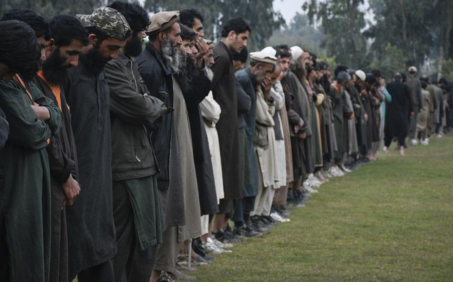 Islamic State fighters line up Nov. 19, 2019 in Jalalabad, Afghanistan after surrendering to the Afghan government. At least 29 people were killed, including civilians, prison guards, security forces and prisoners, in an attack by Islamic State fighters on a jail in the city in eastern Afghanistan that started Sunday, Aug. 2, 2020 and continued for nearly 24 hours.