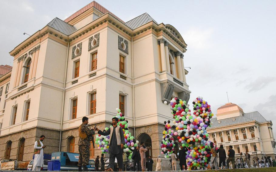 Workers at Darul Aman Palace prepare balloons for a celebration of Afghanistan's Independence Day in Kabul on Aug. 18, 2020. The palace, once riddled with bullet holes and bomb craters, has been restored.