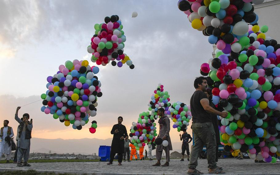 Workers at Darul Aman Palace prepare balloons for a celebration of Afghan Independence Day in Kabul on Aug. 18, 2020. The palace was restored last year.
