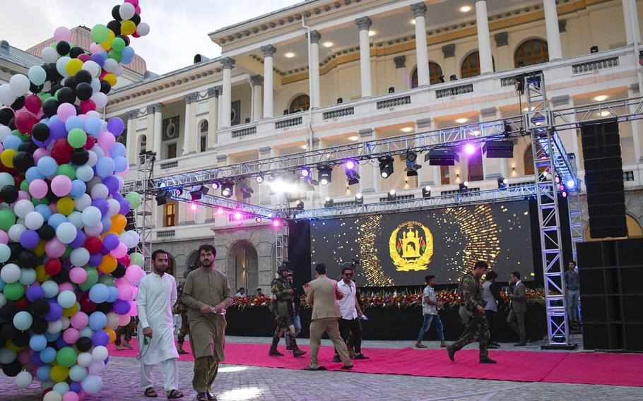 Afghans arrive at Darul Aman Palace to attend a celebration of Afghanistan's Independence Day in Kabul on Aug. 18, 2020. The palace was restored last year after being ravaged by war.