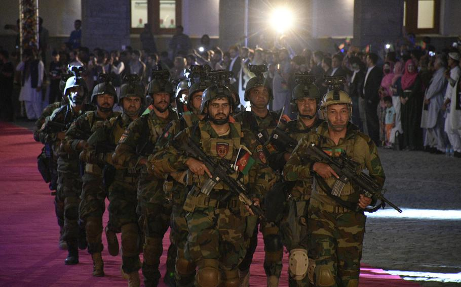 Afghan National Army soldiers parade at the restored Darul Aman Palace for a crowd celebrating Afghanistan's Independence Day in Kabul on Aug. 18, 2020.