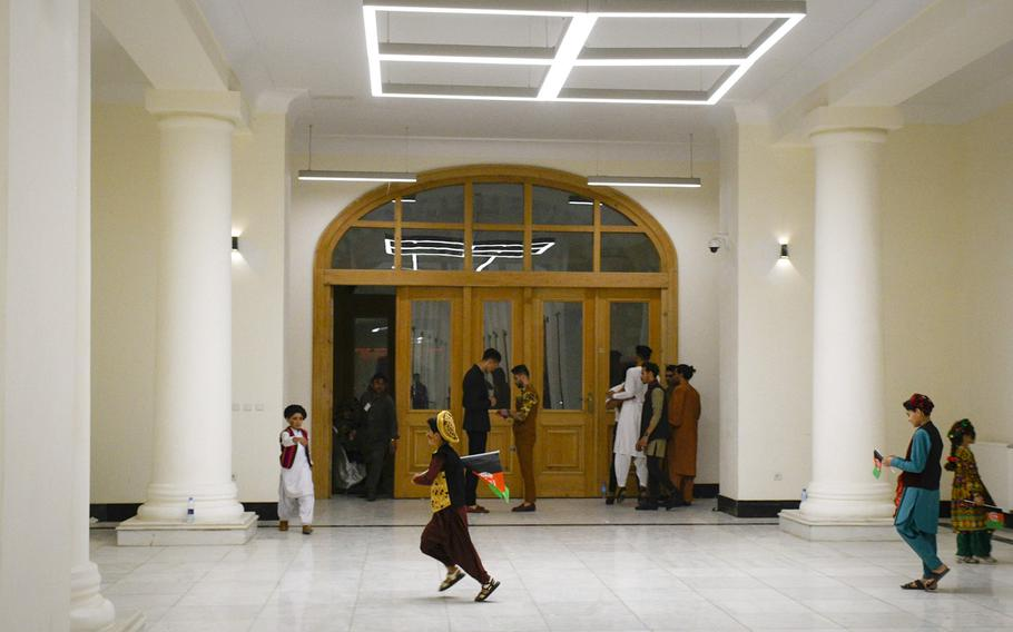 Children play in the halls of the restored Darul Aman Palace in Kabul, Afghanistan after appearing on stage for a celebration of Afghan Independence Day on Aug. 18, 2020.