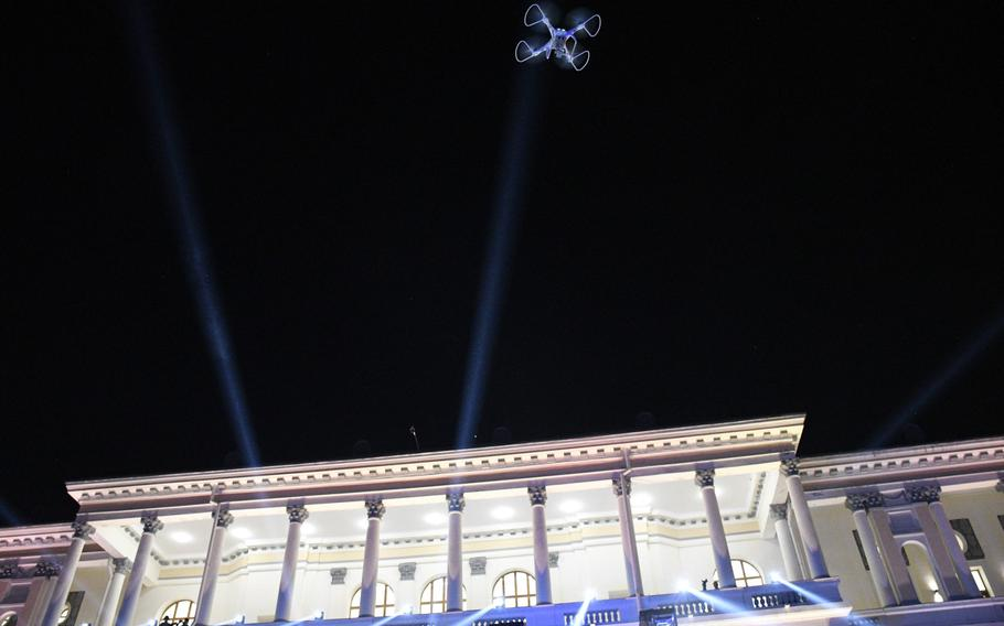 A toy drone flies over the courtyard of Darul Aman Palace in Kabul, Afghanistan during a celebration of the country's Independence Day on Aug. 18, 2020. The palace, once ravaged by years of war, has been restored and was unveiled one year prior.