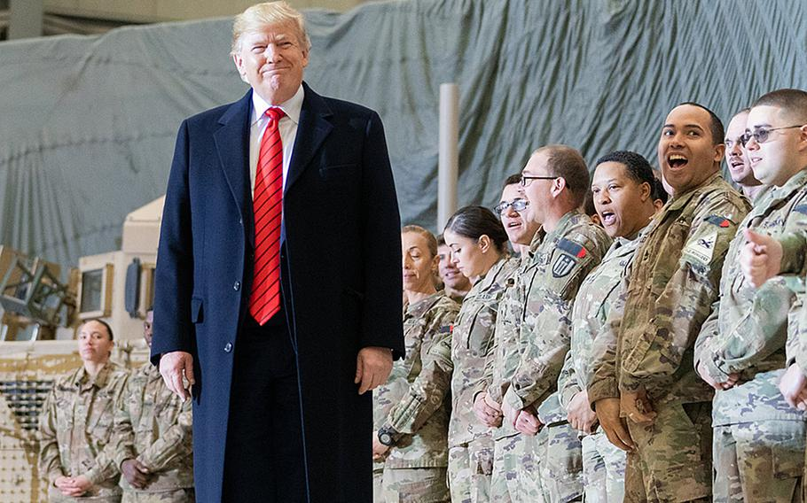 President Donald Trump visits troops at Bagram Airfield, Afghaistan on November 28, 2019, during a surprise Thanksgiving stopover. Media reports indicate Trump will reduce the number of U.S. forces in Afghanistan to 2,500 by mid-January.
