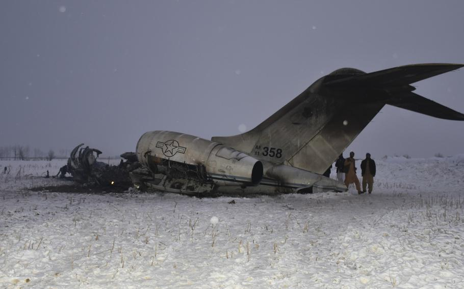 A wreckage of a U.S. military aircraft that crashed in Ghazni province, Afghanistan, is seen Monday, Jan. 27, 2020. The aircraft crashed in Ghazni province on Monday.