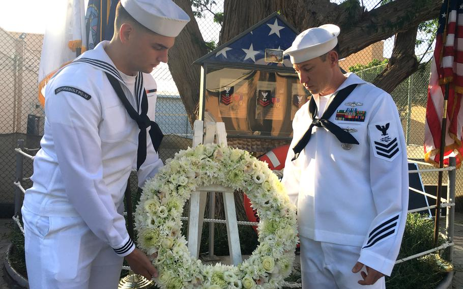 USS Firebolt sailors lay a wreath for the crewmembers of the ship who died in a 2004 suicide attack, during a memorial ceremony at Naval Support Activity Bahrain on April 24, 2019.