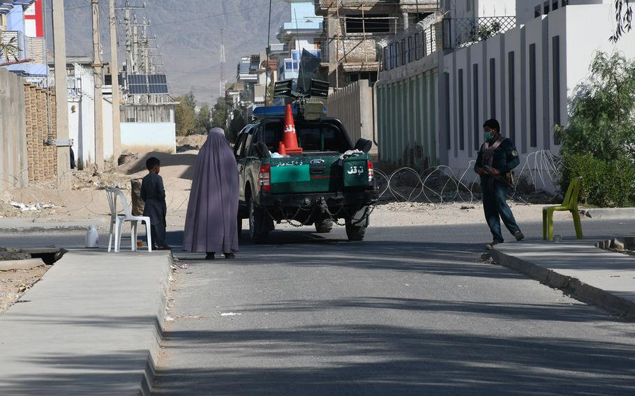 A woman walks down a street in Kandahar, Afghanistan, on Oct. 27, 2018. An attack in the city in July killed seven civilians and wounded more than 70 others, according to the United Nations.