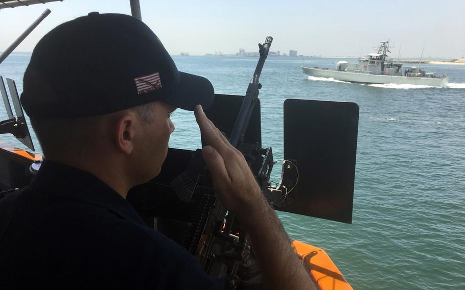 Coastal patrol ship captain Lt. Cmdr. Dale Tourtelotte, from the USS Hurricane, salutes a passing Bahraini patrol ship while underway on June 30, 2019. Ten coastal patrol ships, or PCs, operate in the Persian Gulf and are homeported at Naval Support Activity Bahrain.