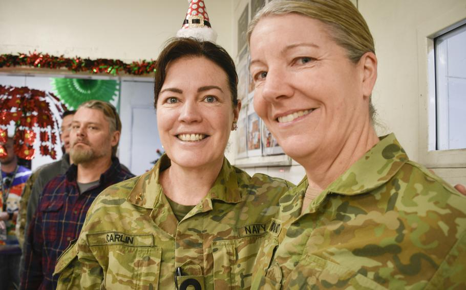 Two Australian troops deployed to the central NATO and international coalition base in Kabul, Afghanistan, celebrate Christmas of 2019 with a holiday meal of shrimp and crab legs in the base cafeteria.
