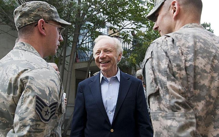 Sen. Joe Lieberman talks to several constituents during a visit to Camp Eggers in Kabul on Sunday. He and Sens. John McCain and  Lindsey Graham helped present several combat infantry badges.