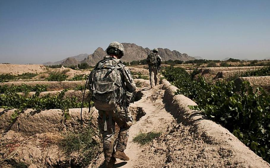 Soldiers from Troop B, 1st Squadron, 71st Cavalry Regiment,  patrol through a grape orchard in Dand district, Kandahar province, Afghanistan. June 19, 2010.
