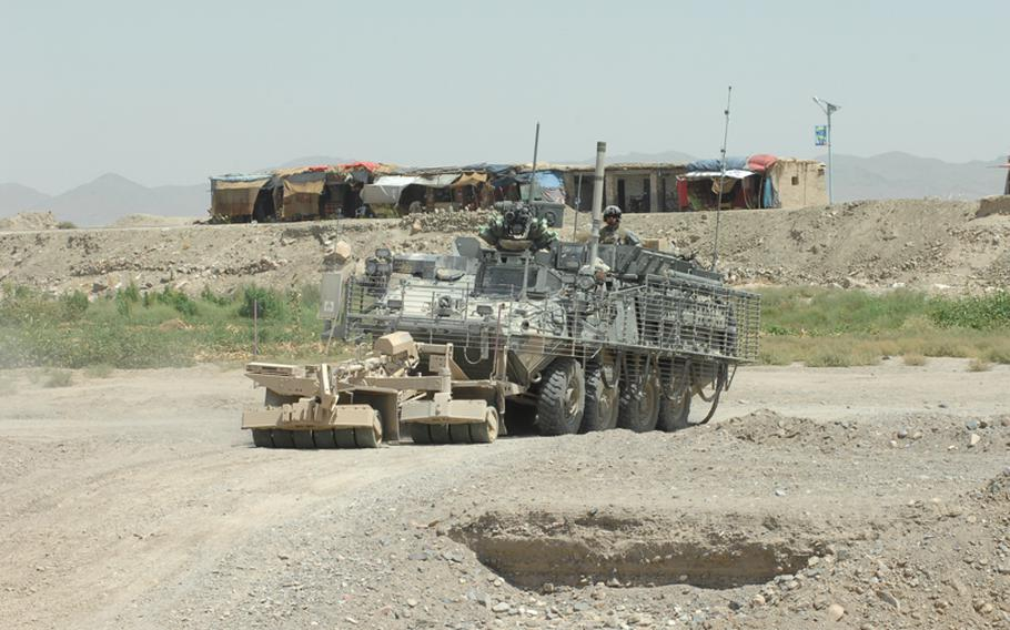 Soldiers with the 2nd Stryker Cavalry Regiment patrol in Kandahar province.