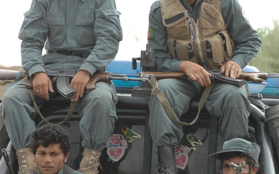 Afghan National Police on guard recently in Tirin Kot, Uruzgan province.