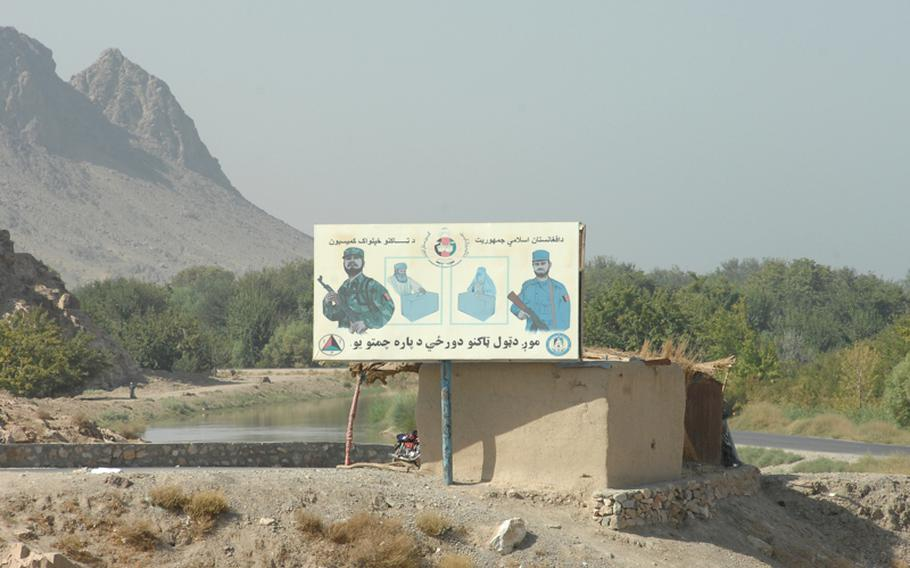 A billboard in Kandahar province depicts voters casting ballots under the protection of the Afghan police and army. Parliamentary elections are scheduled nationwide on Sept. 18.