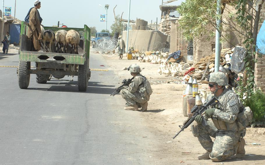 Soldiers with the 2nd Stryker Cavalry Regiment patrol alongside Afghan National Police in Kandahar province.