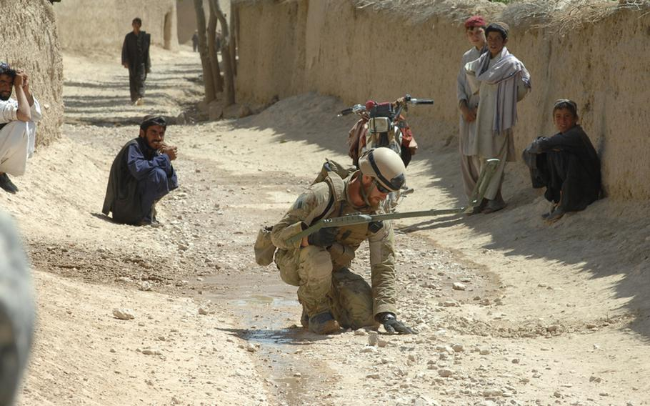 Navy Construction Mechanic Mikel Irvine, 26, of Tucson, Ariz., searches for a bomb during a counter-IED operation in Helal China, Zabul province, Afghanistan recently.