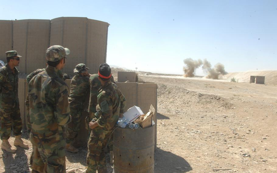 A group of Afghan commandos watches an explosion during counter-IED training at Kandahar Air Field on Sunday, Sept. 26.