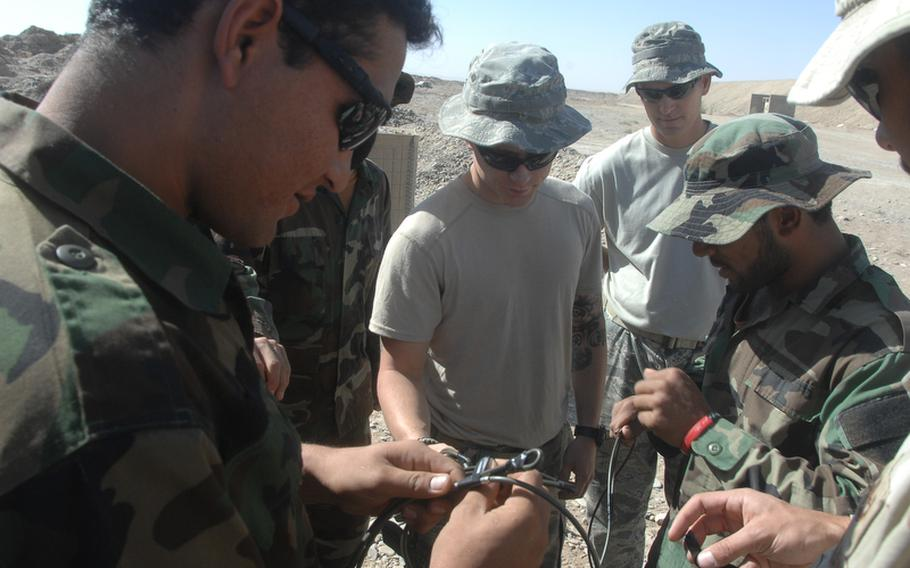 U.S. personnel train Afghan commandos to defeat improvised explosive devices at Kandahar Air Field on Sunday, Sept. 26.