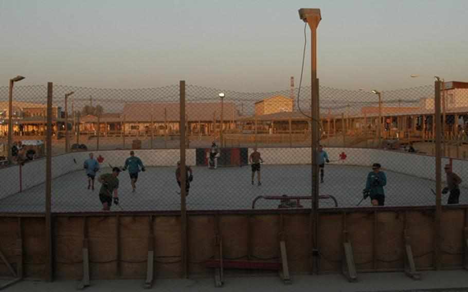Players scrimmage in preparation for the upcoming season of the Kandahar Hockey League at Kandahar Airfield in southern Afghanistan. Last season, there were 24 teams in the ball hockey league -- 21 made up of Canadians, two from Slovakia and one from the United States.