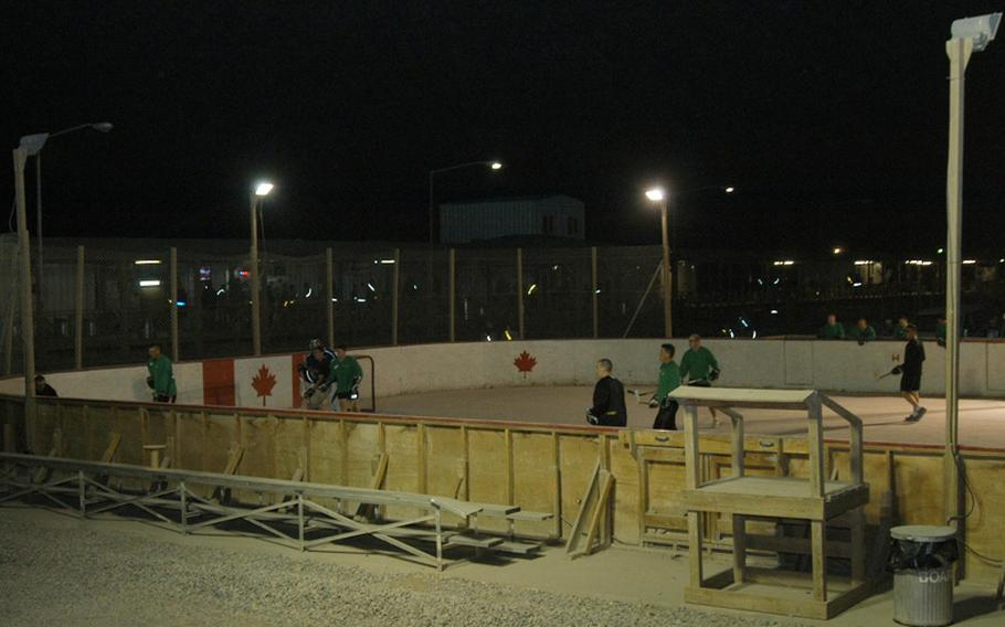 American servicemembers scrimmage against each other in preparation for the upcoming ball hockey season at Kandahar Airfield in southern Afghanistan. The rink is one of the unusual sights at the KAF boardwalk, where visitors and residents can shop or dine at about two-dozen shops and restaurants, or play a variety of sports in the common area in the middle of the boardwalk square.