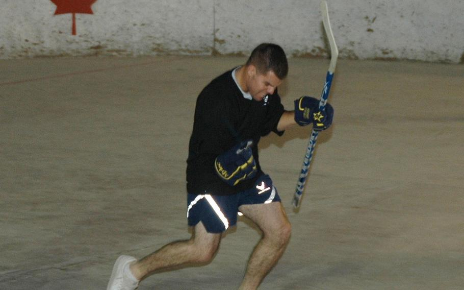Airman 1st Class Ryan Dukett celebrates a goal with what he called his 'Tiger Woods fist-pump' during a scrimmage of American players preparing for the upcoming season of the Kandahar Hockey League, a ball hockey organization based at Kandahar Air Field in southern Afghanistan.