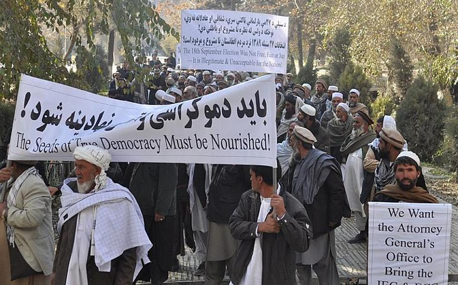 Afghan parliamentary candidates march in Kabul on Nov. 28 to protest the questionable outcome of the fraud-riddled Sept. 18 elections.
