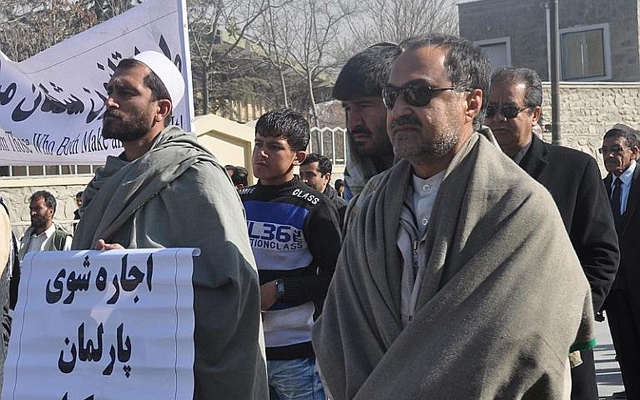Parliamentary incumbent candidate and protest organizer Daoud Sultazanoi (right), marches along with fellow demonstrators in Kabul on Nov. 28 against fraud-riddled elections that led to their losses.