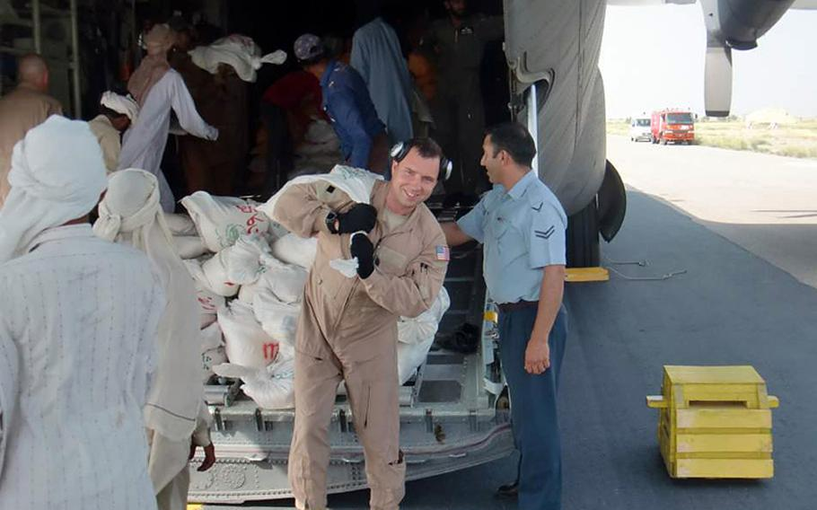 New York Air National Guard Staff Sgt. Anthony Legotti helps unload humanitarian aid in Pakistan during the U.S. military relief effort in the wake of devastating floods in the country this summer.