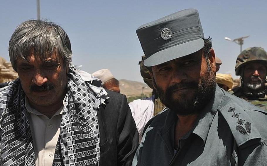 Atiqullah Lodin, left, governor of Logar province, and Ghulam Sakhi, Logar's police chief, attend a shura in the southern district of Kherwar in early May.  Martin Kuz/Stars and Stripes